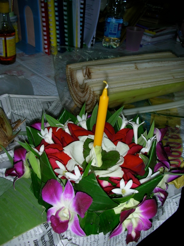 The Krathong I made. I used banana leaves, orchids, lotus flowers, roses, and some other white flower.